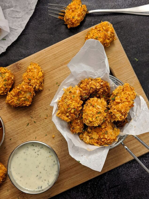 s 10 make at home recipes that are better than ordering take out, Cornflake Crusted Cajun Popcorn Chicken Bake