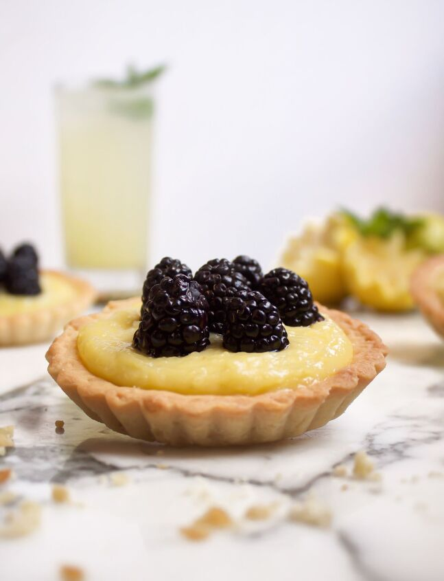 s 18 mini desserts that ll convince you to skip the pie this year, Mini Lemon Blackberry Tarts