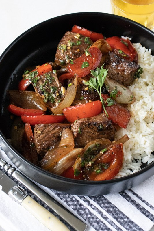 marinated sirloin steak tips with peppers and onions