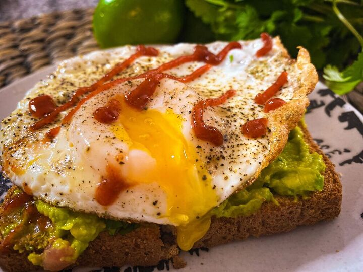 lite sunnyside up egg on avocado toast