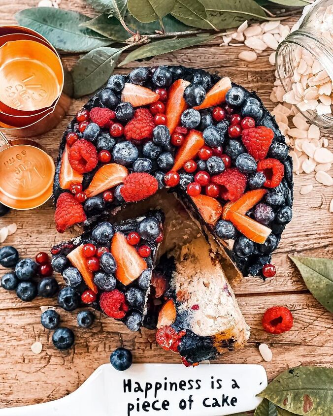 healthy almond cookie dough cake with chocolate frosting and berries