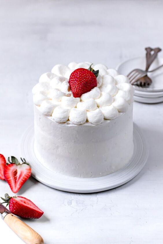 white cake with strawberries and mascarpone frosting