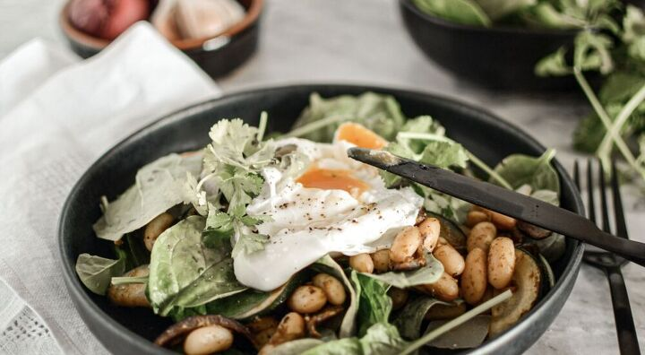 pesto bean and courgette brunch salad with poached egg