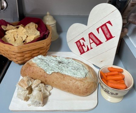 dill icious spinach dip mix served in a bread bowl