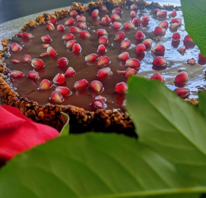 chocolate pomegranate tart with date and nut base